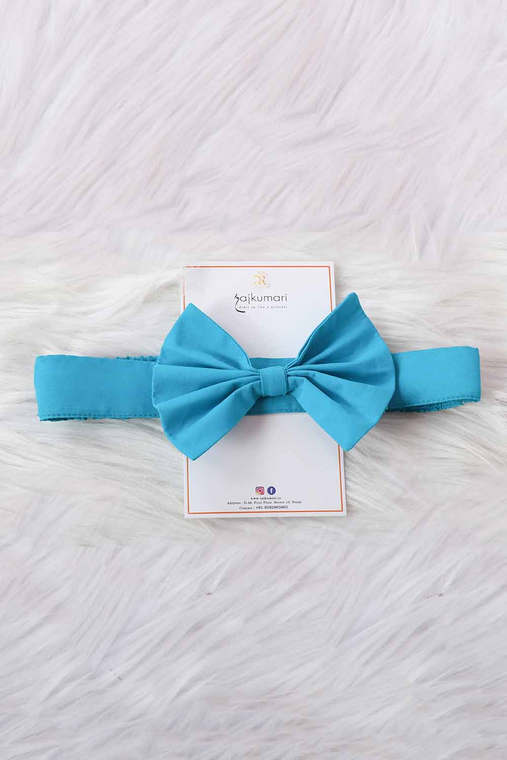 Blue headband with bow design