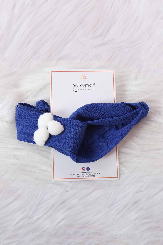 Navy Blue headband with white pom-pom attached