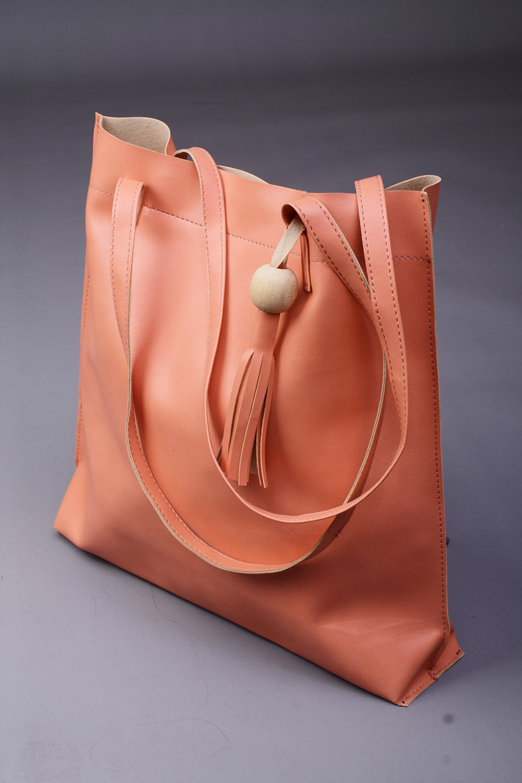 Peach Handbag with beautiful Tassel